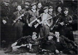 """Jeż"", standing fourth from left is holding an MP 40 sub-machine gun."