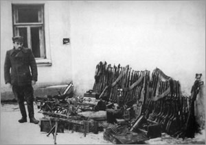 "Lt. ""Żbik"" after his arrest. Photo taken next to the weapons cache discovered by the UB in Wola Węgierska near Jarosław."