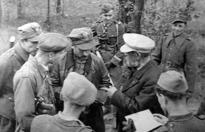 "June 1945. The soldiers from the Protection Unit of KG DSZ, meeting with Capt. Wacław Rejmak, nom de guerre ""Ostoja"" - a Commandant of the OP"